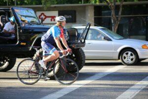 A cyclist on an busy city street