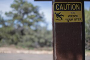 """a sign reading """"caution ice watch your step"""""""
