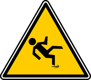 a warning sign depicting a slippery floor