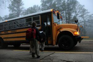 Children getting a school bus