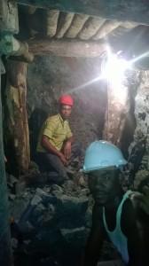 Miners in the larimar mine