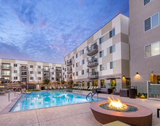 The Thomas at Midtown Phoenix Apartments Pool Featuring Lounge Area with Fire Pit