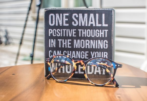 photo-of-a-sign-and-eyeglasses-on-table-1485657