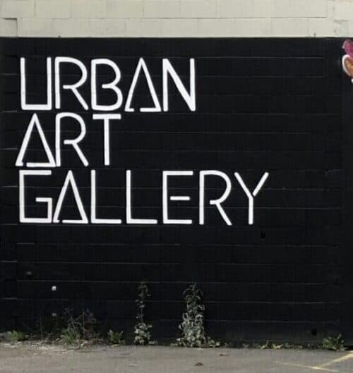 Large hand painted text saying 'Urban Art Gallery'.