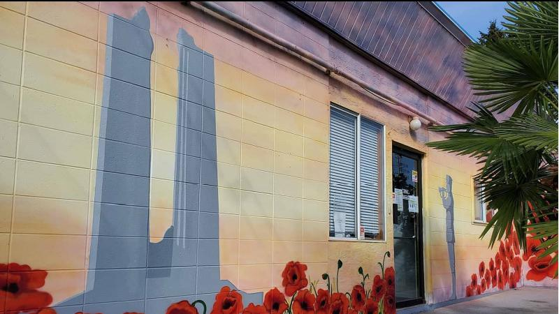 Mural featured Vimy Ridge War Memorial with Bugler and poppies