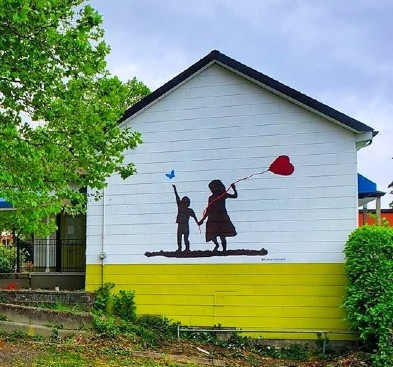 Mural is of two children holding hands