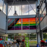 Inclusive flag window painting - humanity in art.