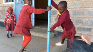 5 year old girl at classroom door