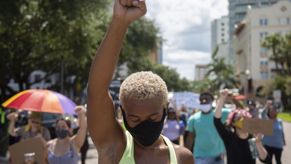 Tiffany Taylor, 24, raises her fist during protests in St. Petersburg Sunday, June 14, 2020. [PENDYGRAFT | Times]