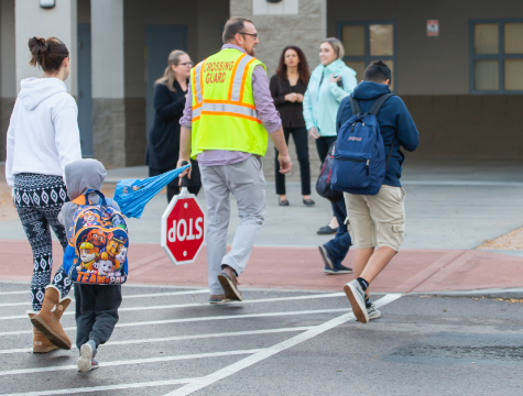 Photo: Crossing guard helping students cross street