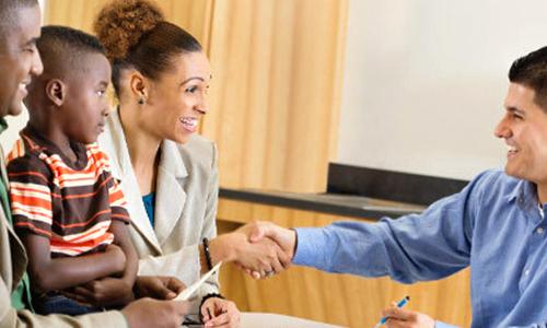 Photo: Parents shaking teachers hand
