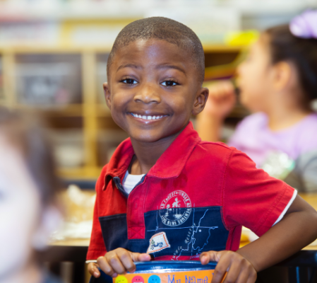 Photo: Student looking at the camera smiling