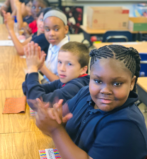 Photo: Students clapping