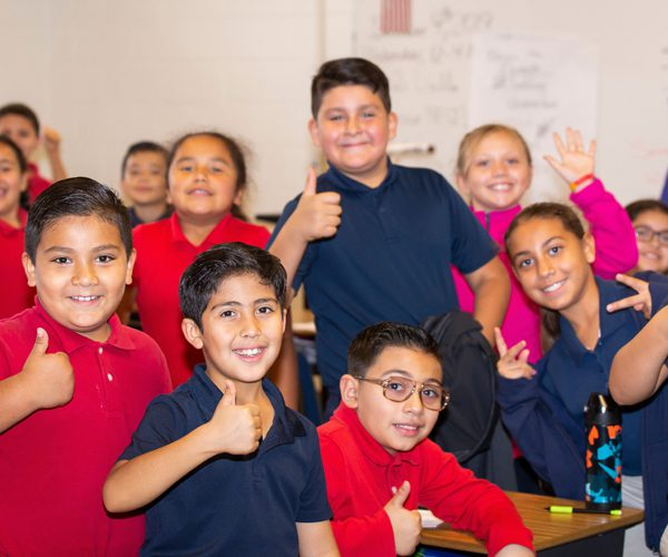 Photo: Group of students with thumbs up