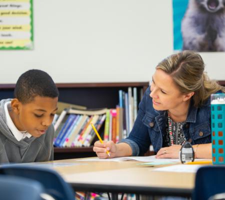 Photo: Teacher helping student
