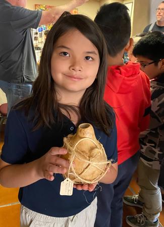 Photo: Student holding craft