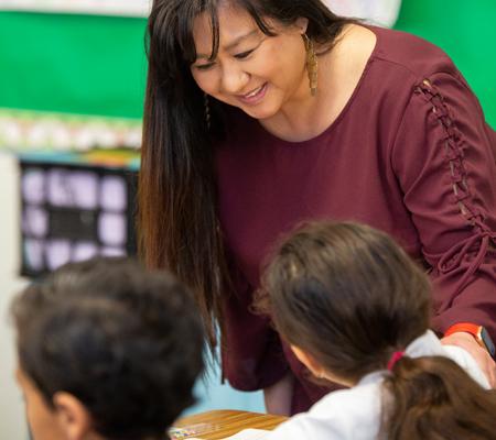 Photo: Teacher talking to student
