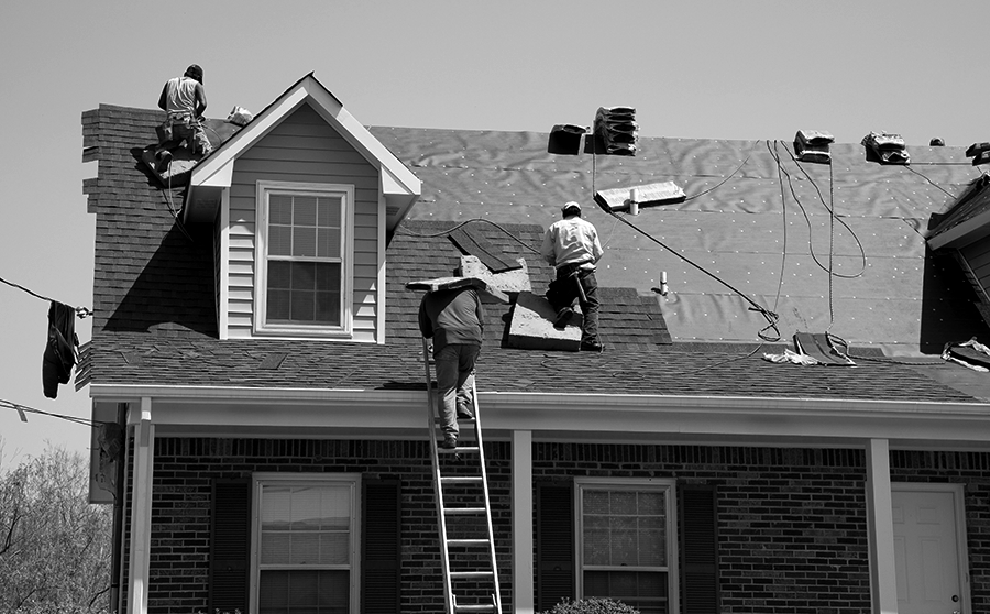 Roofers Working on Residential Roof in Chicago