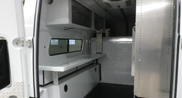 Fiber optic splicing vehicles