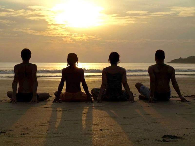Jesse Frechette leads a meditation by the ocean.