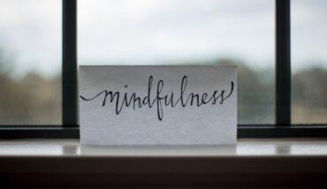 A piece of paper with 'mindfulness' written on it.