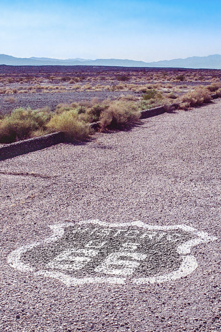 US_Route66 Amboy CA California historic sidewalk highway with curb by Roy's Motel and cafe © Paul Kostadimas Spotlight Sojourns_Album Cover