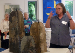 "Dianne Corso discussing ""Cactus"" at show opening"