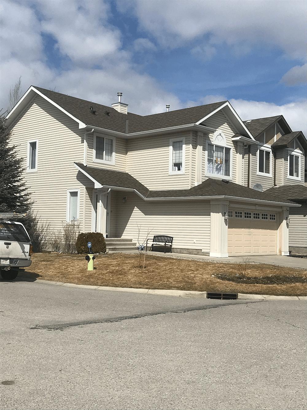 shingles on modern white house