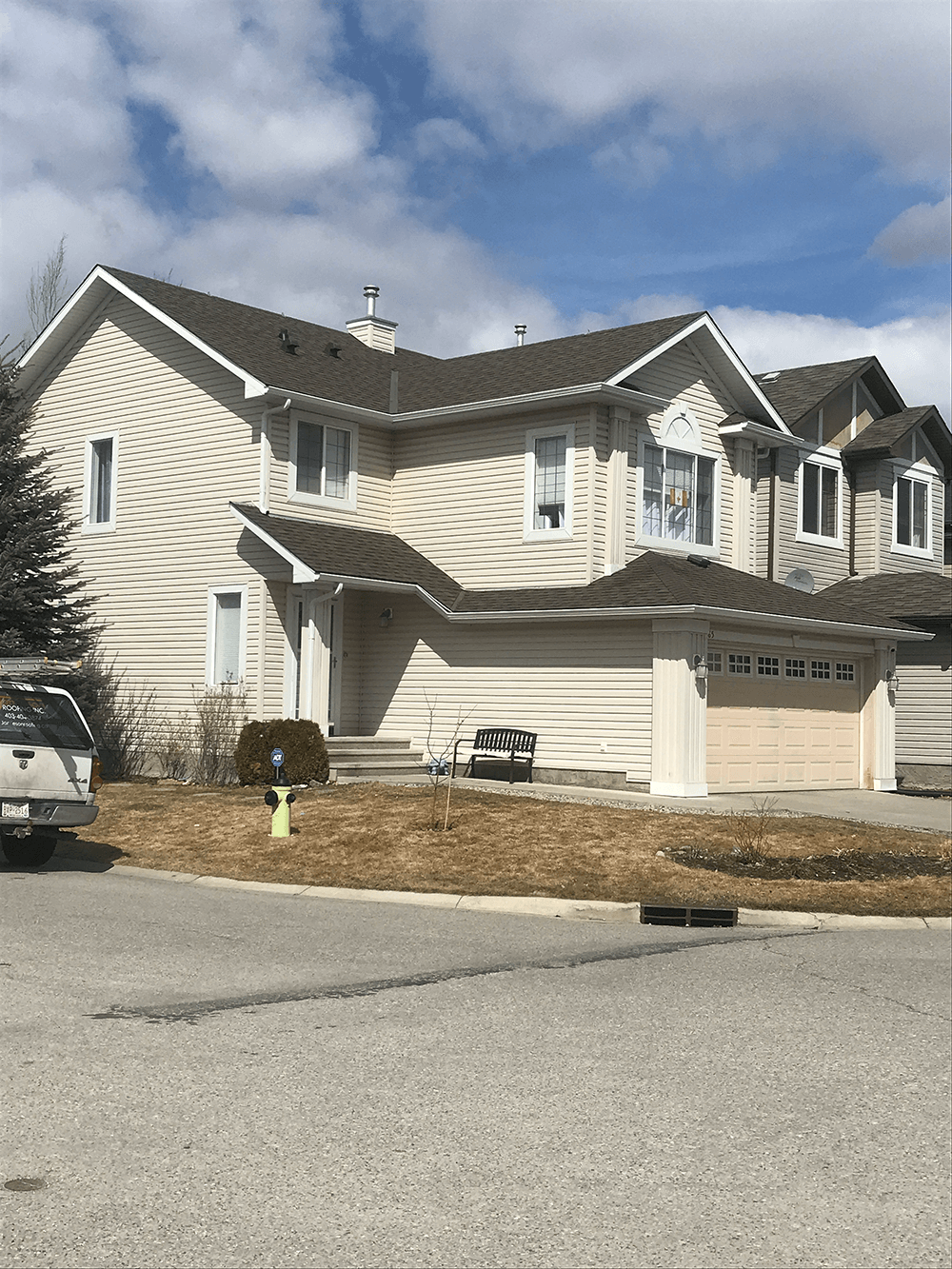 new shingles on modern white house