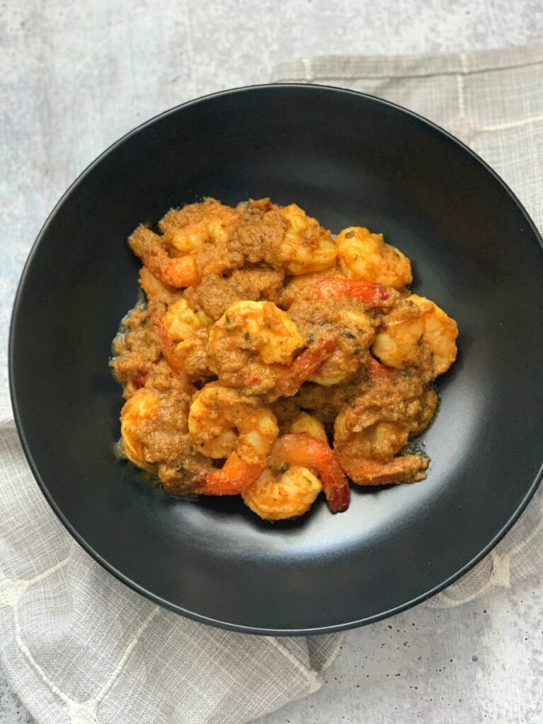 Bunjal Shrimp Curry in a black plate