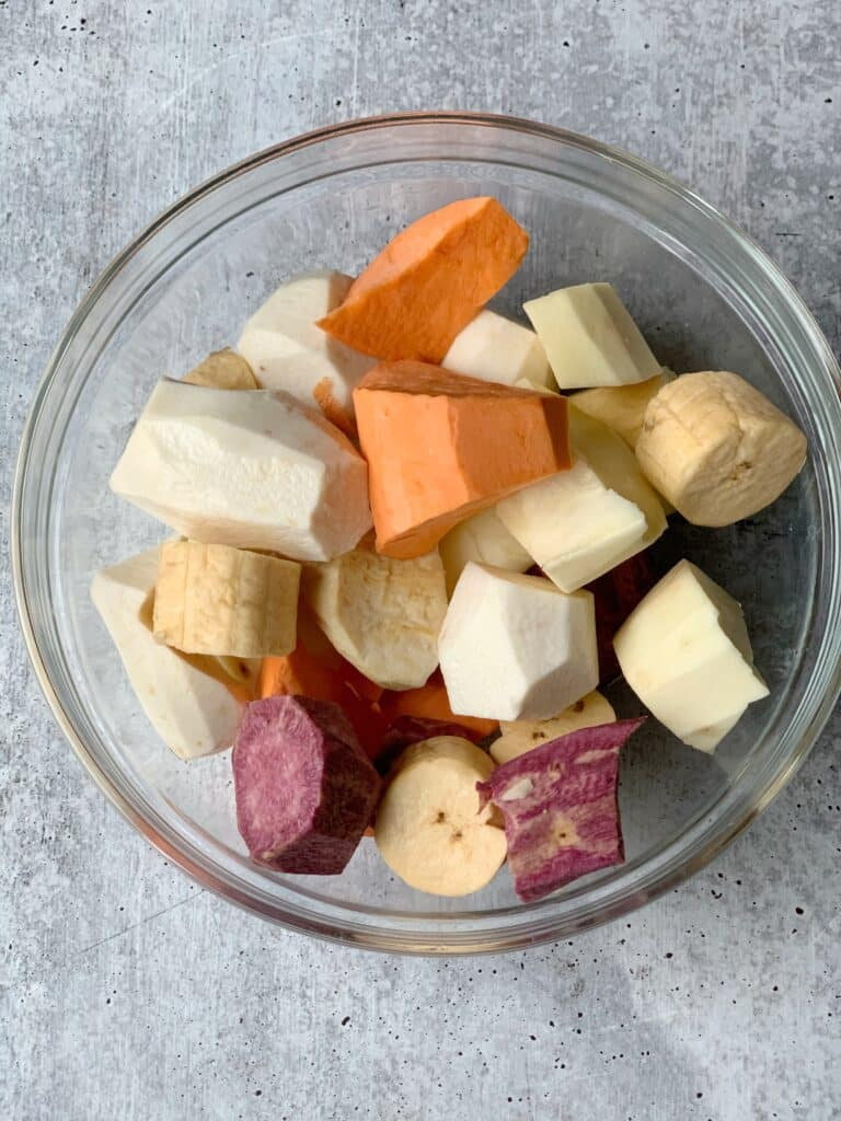 Glass bowl filled with root vegetables