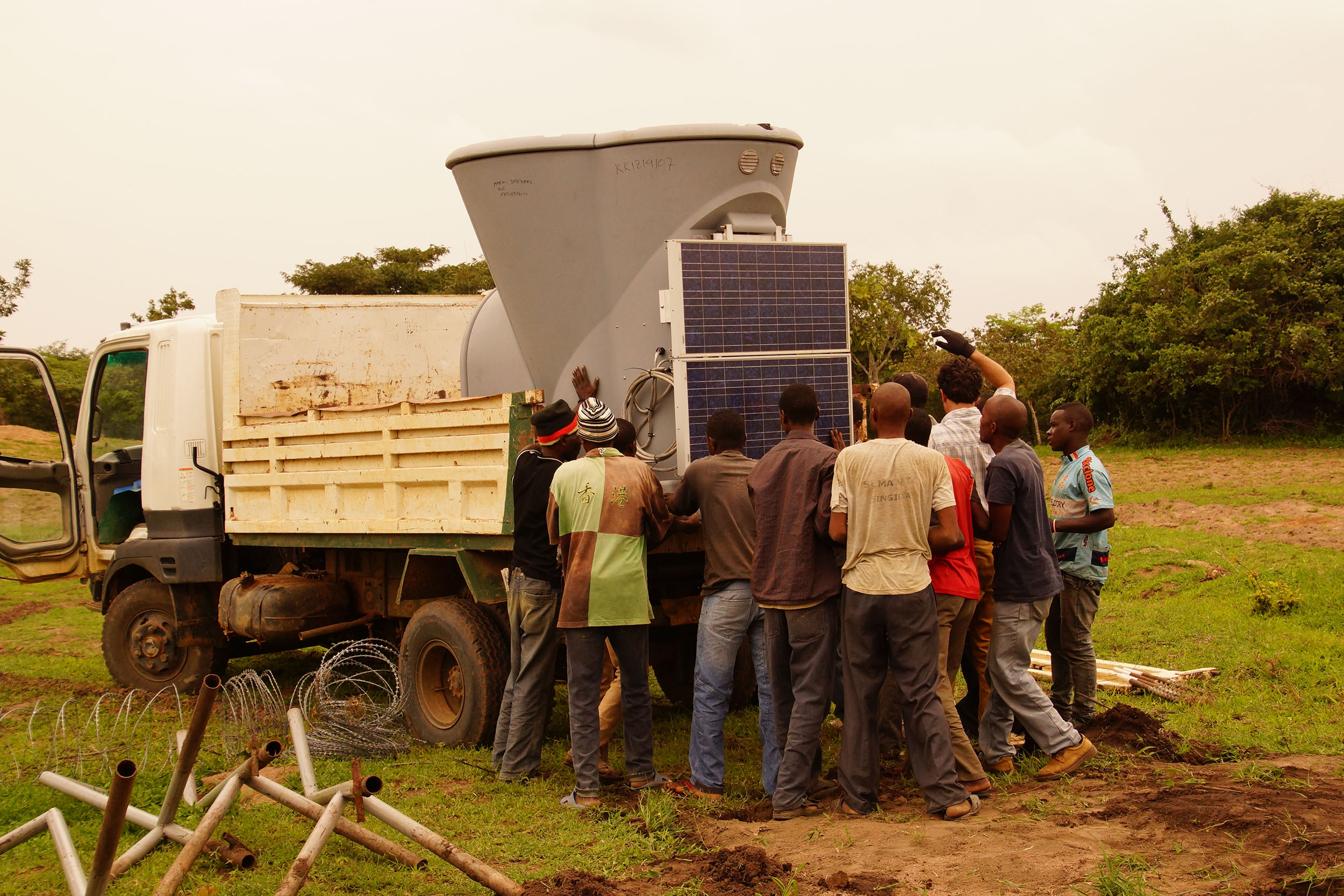 The team loads a SODAR unit and its solar panel onto a truck to move it to another location. The two SODAR units on site are moved periodically to provide additional wind data from multiple locations across wind farm site.