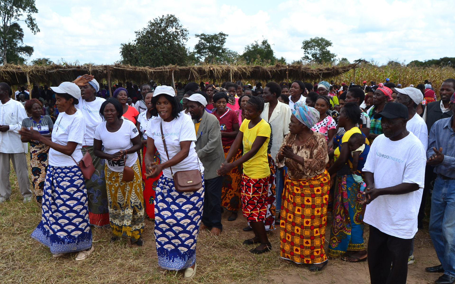 Villagers dance in celebration of the development of the wind farm.