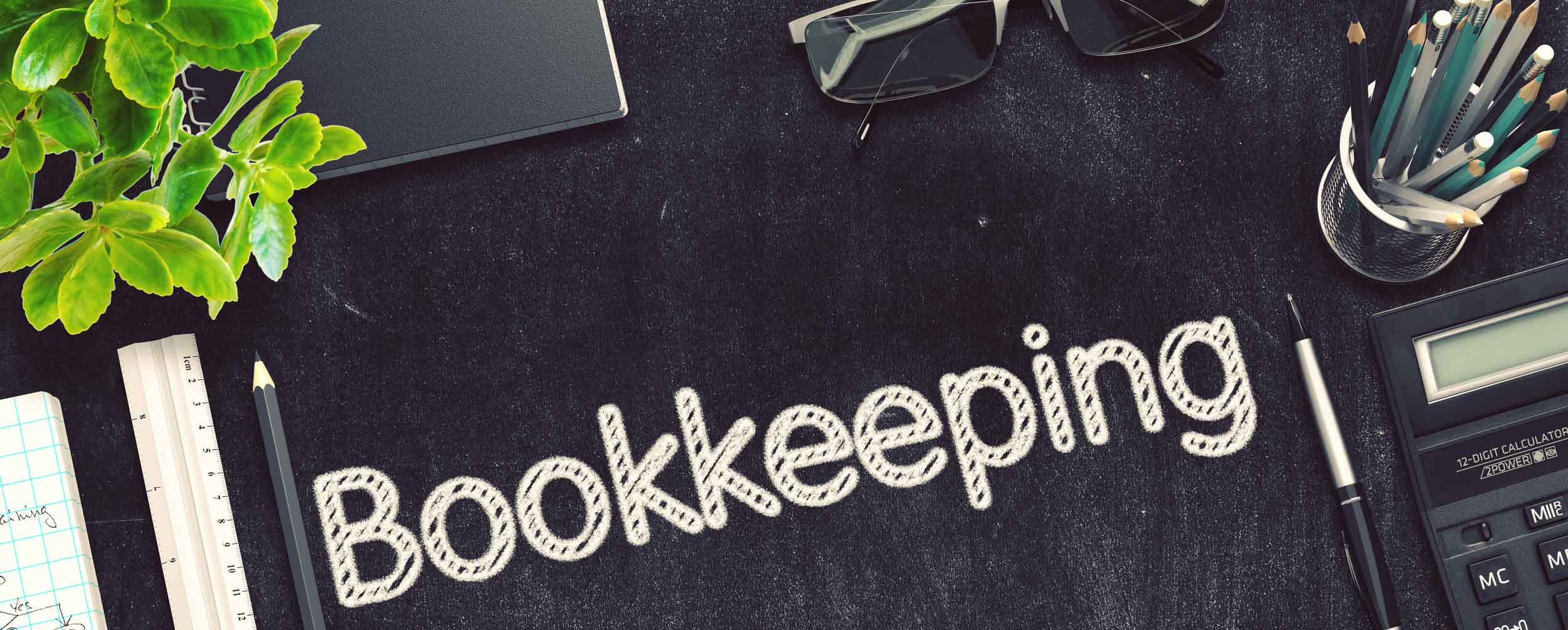 Mobile image the word Bookkeeping on a black desk with a calculator