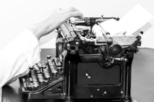 PS Dobie working on old typewriter