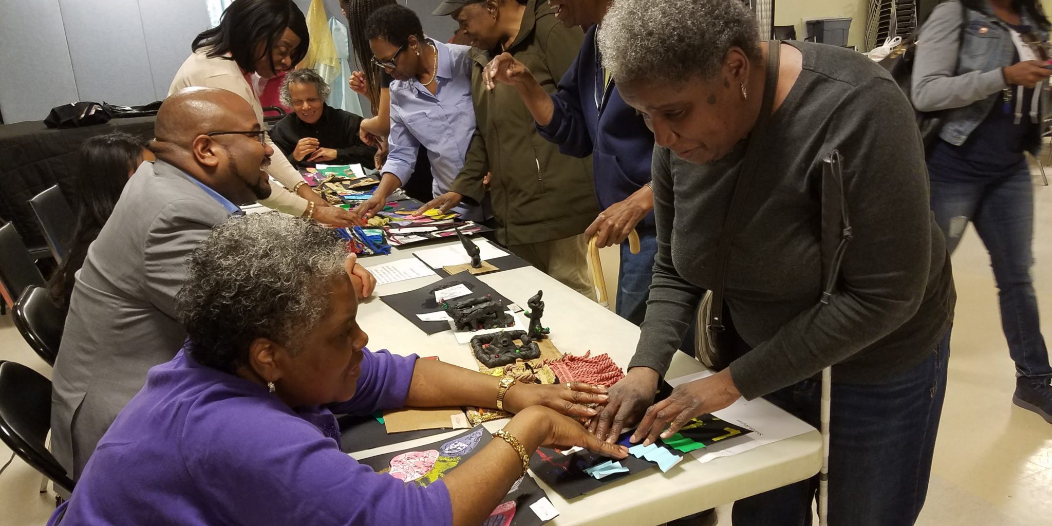 creative aging program participants work on crafts together at a common table
