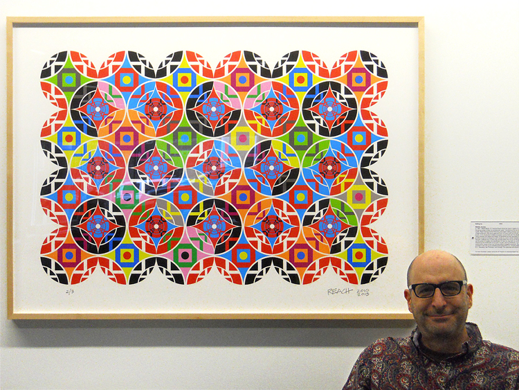 "Andrew Reach in front of the work ""Getting Up"" at Cleveland Clnic Lutheran Hospital"