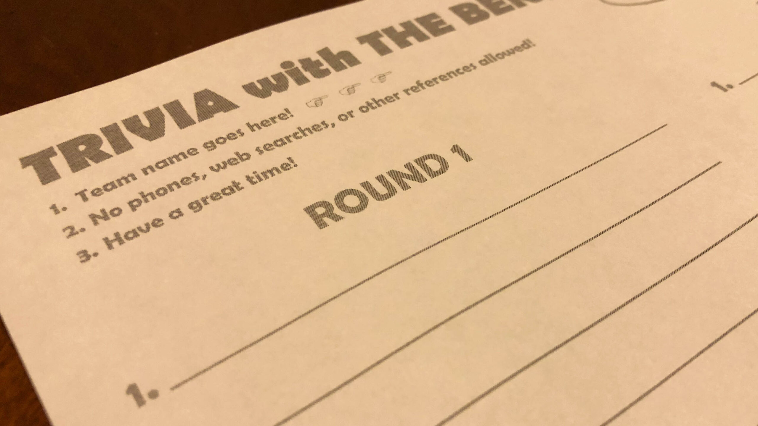 """A photo of a blank trivia answer sheet. The center of the photograph reads """"Round 1"""""""