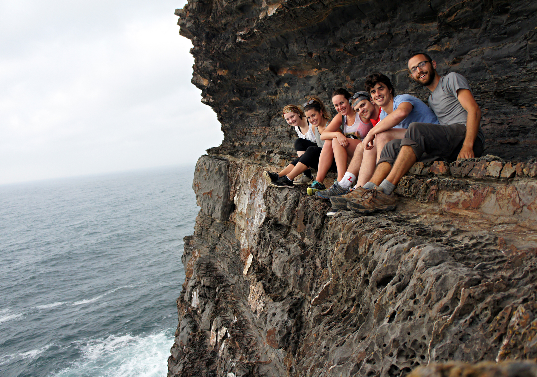 T.J. leads a group through the cliffs of Lagos, Portugal with West Coast Adventure Co.