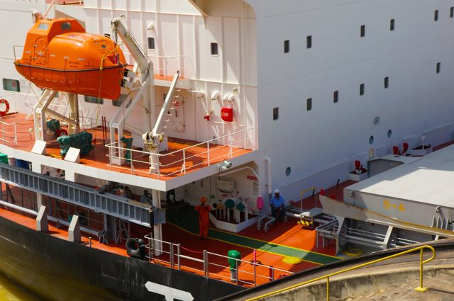 People on a ship pass through the panama canal. Learn more with 10 fascinating facts about the Panama Canal.