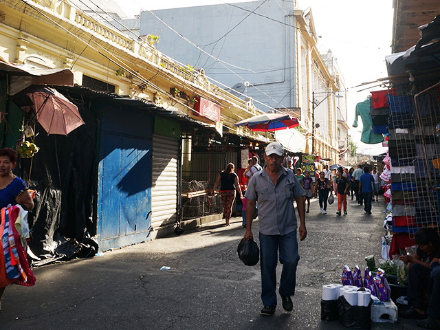 traveling alone in el salvador- man walks the streets of san salvador
