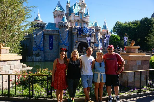 celebrating disneyland 60th anniversary in photos my family in front of castle