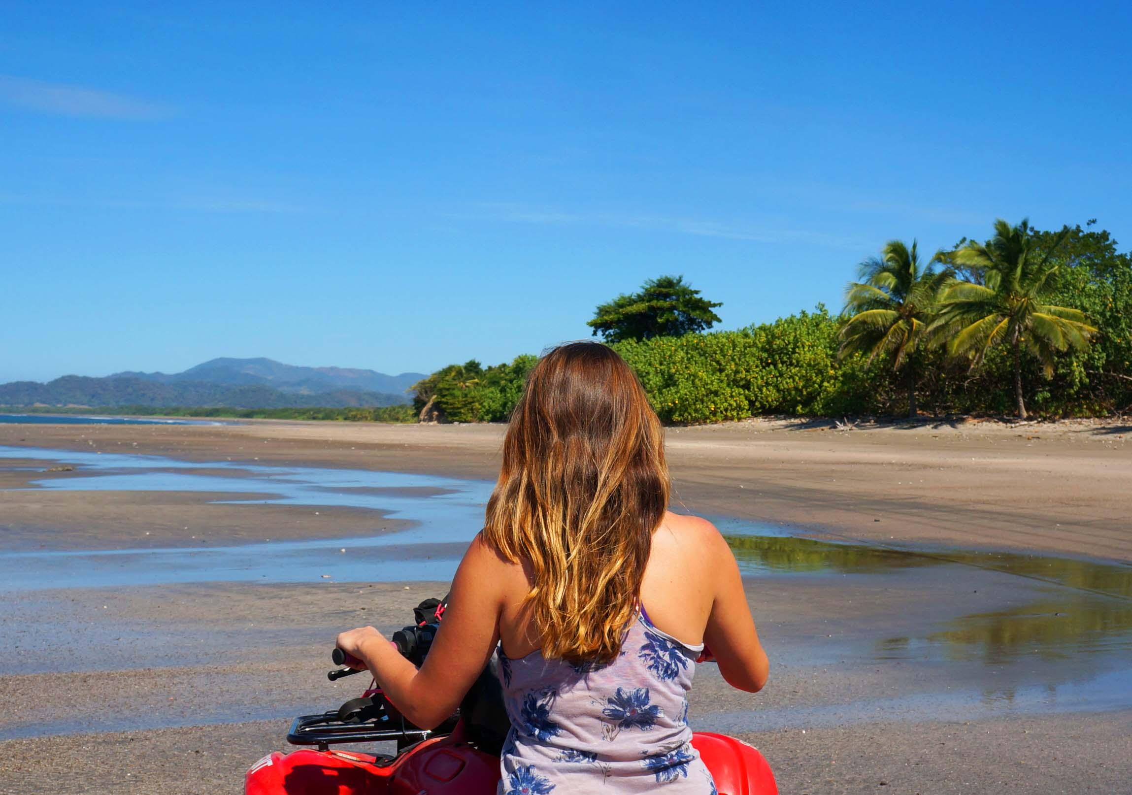 beach exploring with an atv rental in santa teresa featured