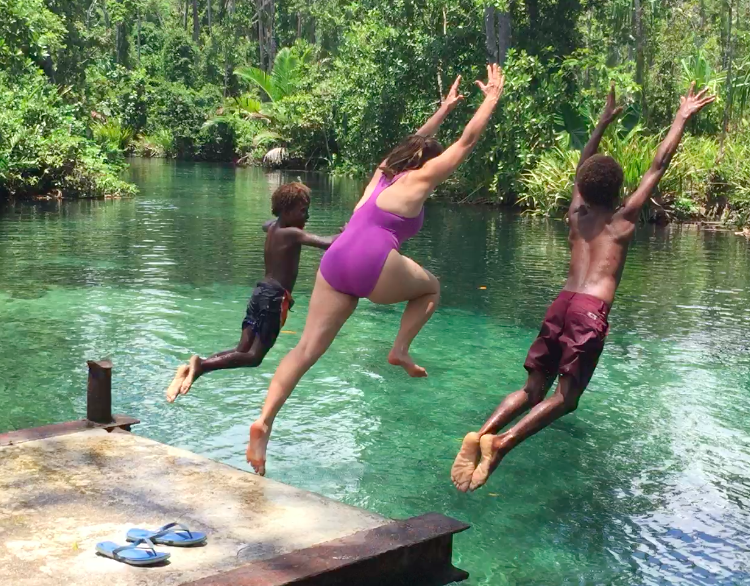 jump in the water on an island road trip in papua new guinea