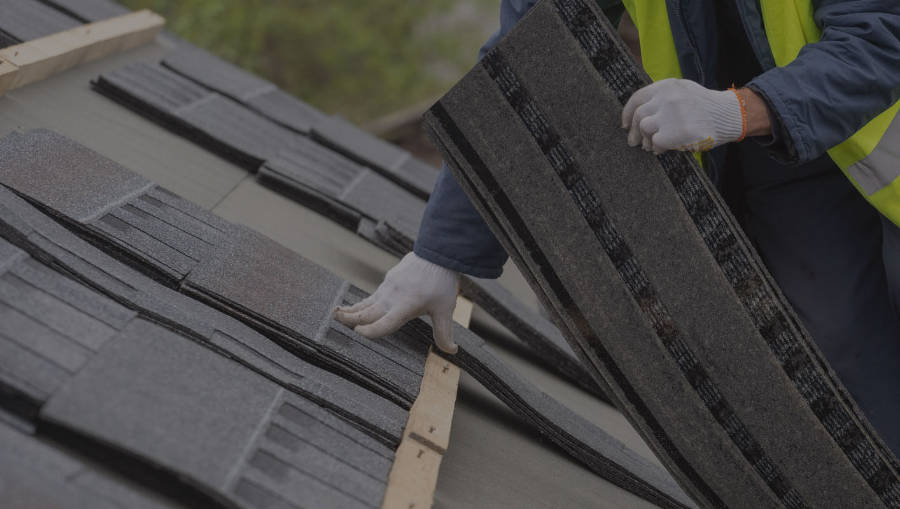 Amerdec Construction Commercial Contractor adding roof tiles