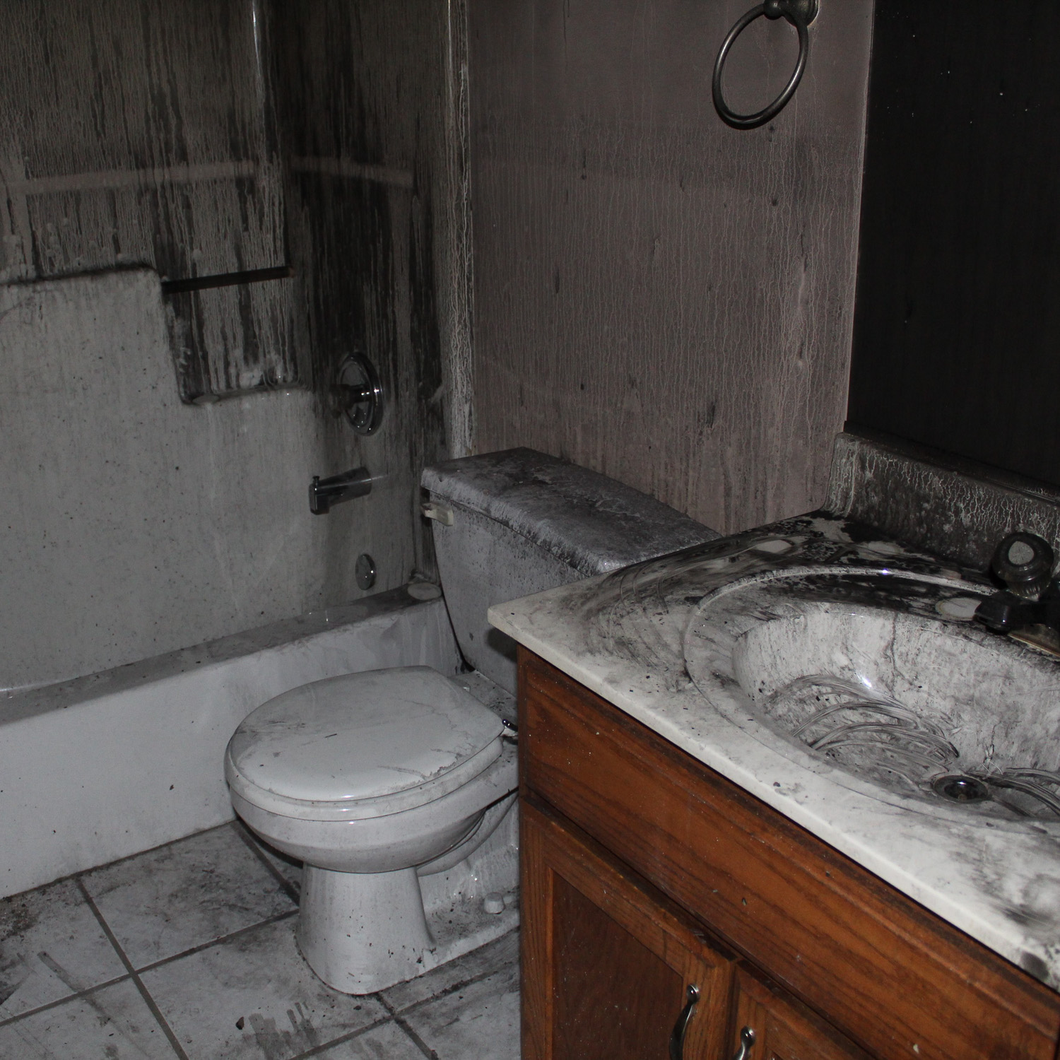 bathroom with fire damage. Soot and smoke damage in a bathroom.