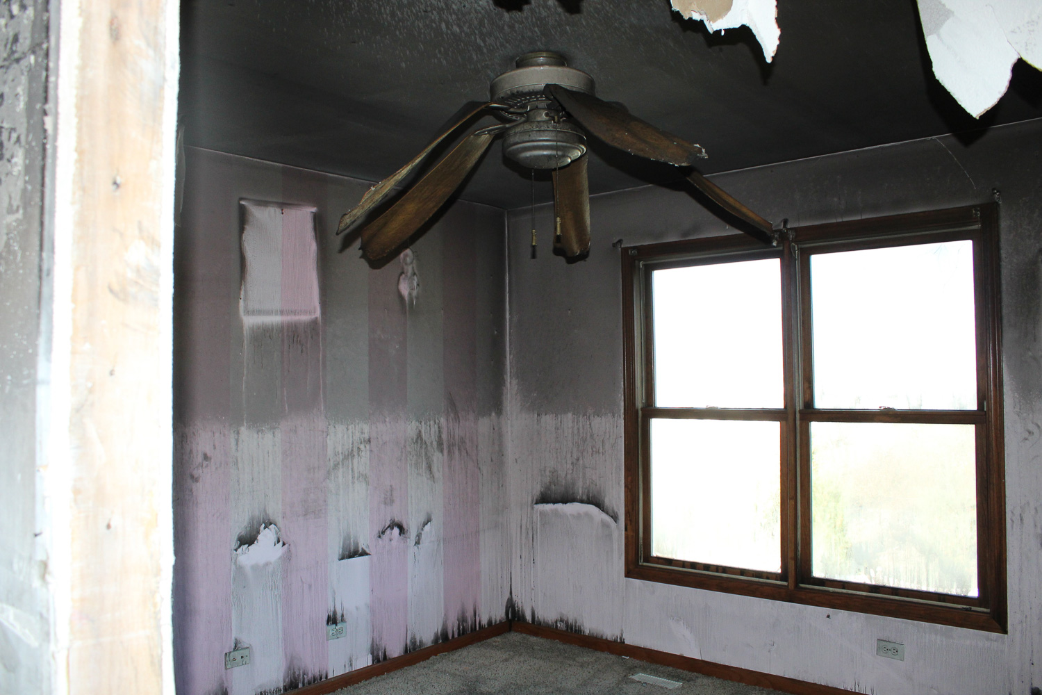 fire and smoke damaged bedroom before restoration project