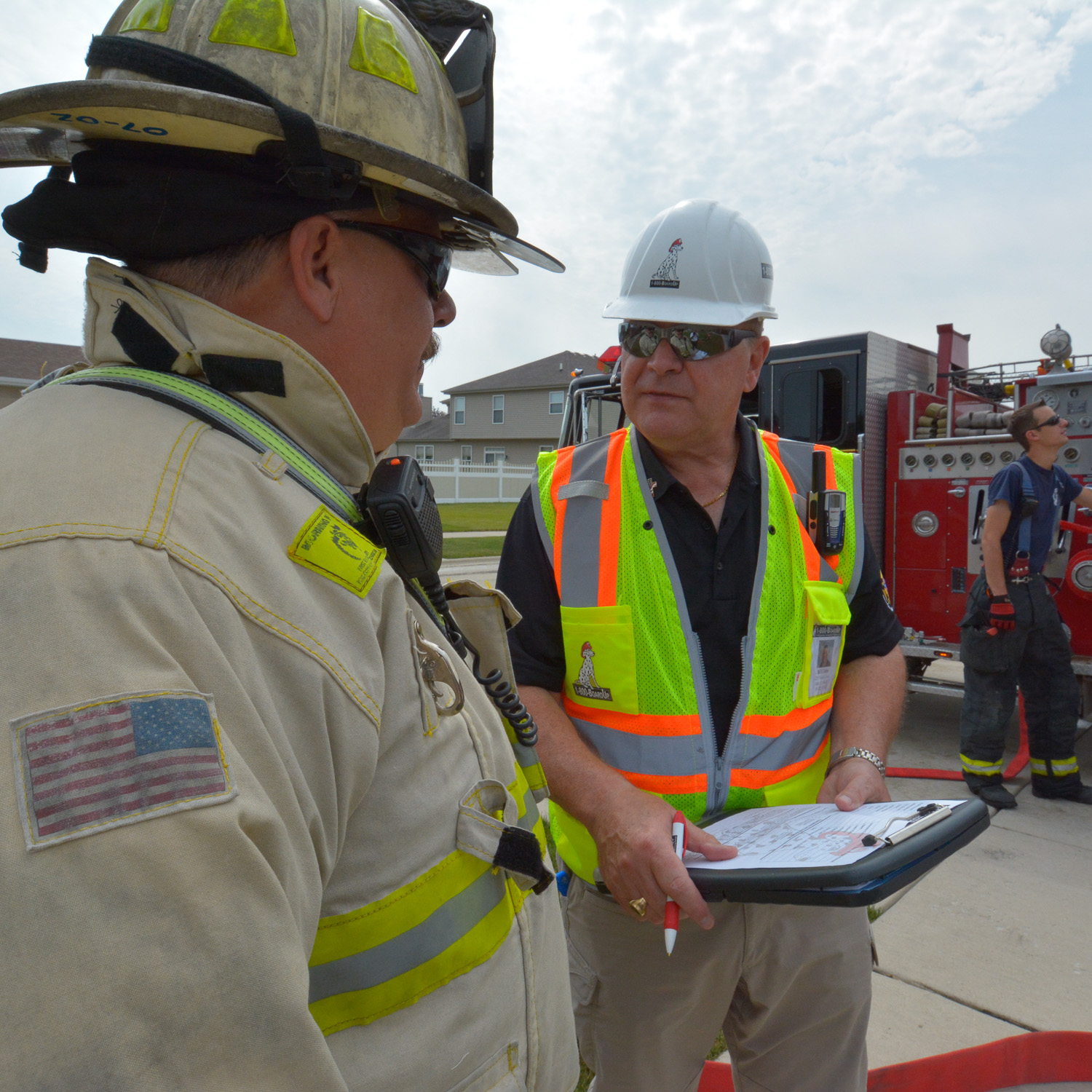 the boardup direction talking to a fire chief at the scene of a fire incident