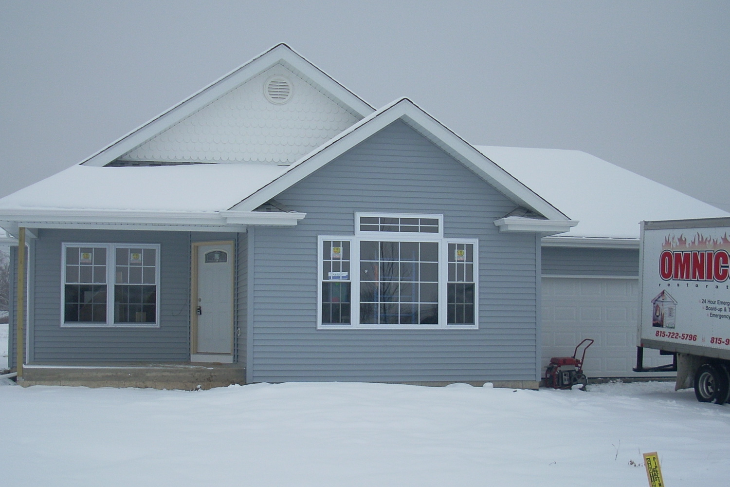 completed house rebuild. New house built after house fire left the old house un-salvageable.