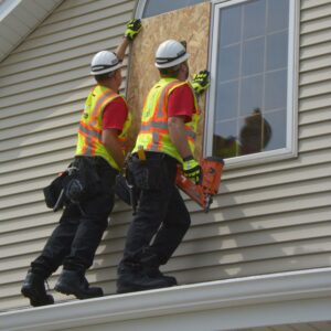 crew boarding up window on a house - 24/7 emergency services for board up of a house